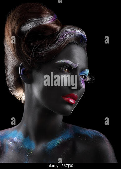 Body-painting. Fantasy. Woman with Fantastic Stagy Makeup over Black - Stock Image