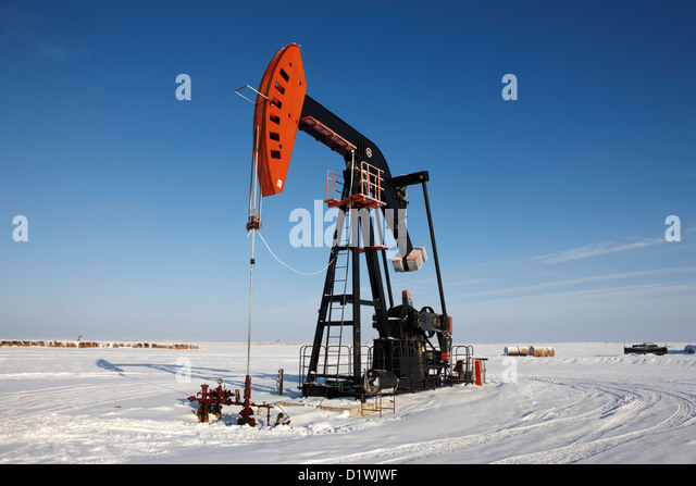 oil pumpjack in winter snow Forget Saskatchewan Canada - Stock Image