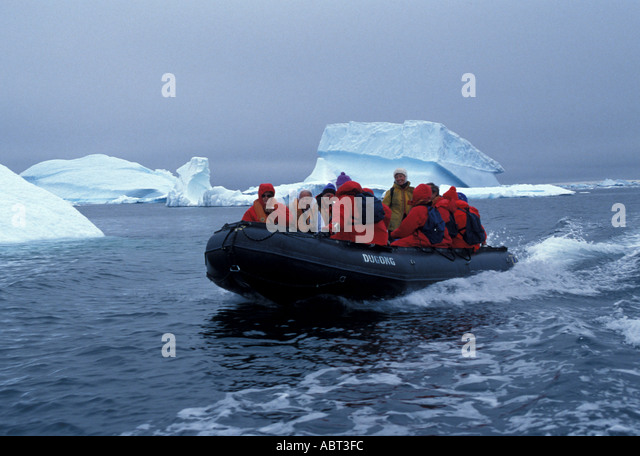 ANTARCTICA Zodiac Landing at Cuverville Island icebergs overcast day - Stock Image