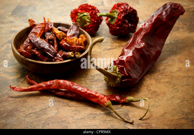 Assortment of dried chili peppers - Stock Image