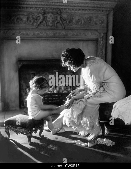 Mother Counting Child's Toes, Circa 1915 - Stock Image
