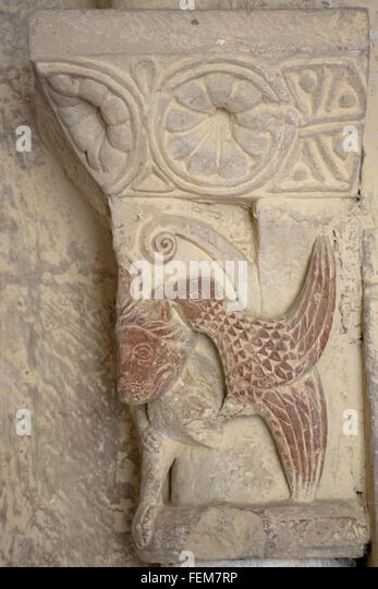 Bird pecking at lion carved capital in Croute church Gers France - Stock Image