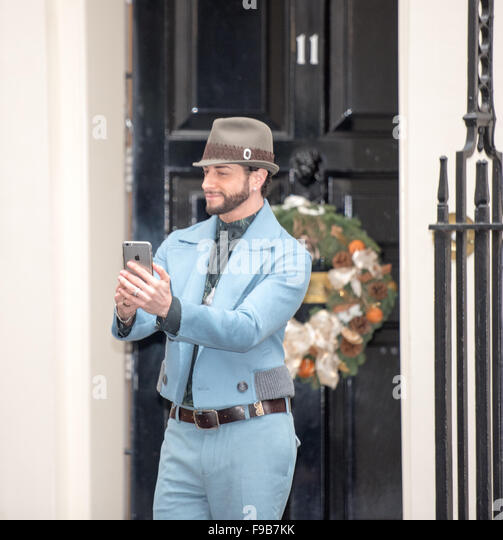 London, UK. 15th Dec, 2015. Brian Friedman of X Factor and I'm a Celebrity TV shows  takes a selfie outside - Stock Image