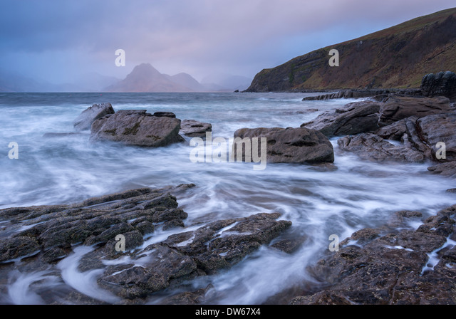 Dramatic coastline of Elgol, looking across to the Cuillins, Isle of Skye, Scotland. Winter (November) 2013. - Stock Image