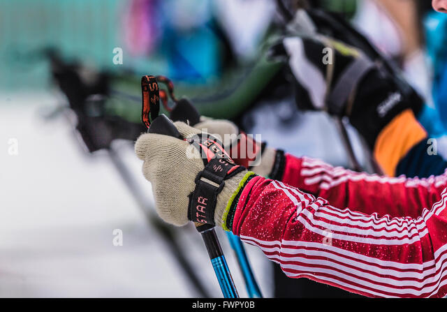 Kyshtym, Russia -  March 26, 2016: Mass start of skiers athletes, closeup of hands and ski poles during cross country - Stock-Bilder