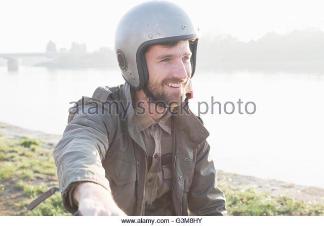 Portrait of man wearing crash helmet - Stock Image