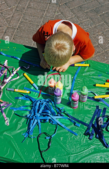 Boy crafts project Earth Day Celebration Jacksonville Florida - Stock Image