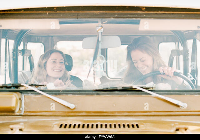 Two women on an outing in the desert, driving in a 4x4. - Stock Image
