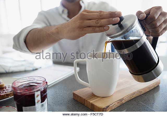 Man pouring coffee from French press - Stock Image