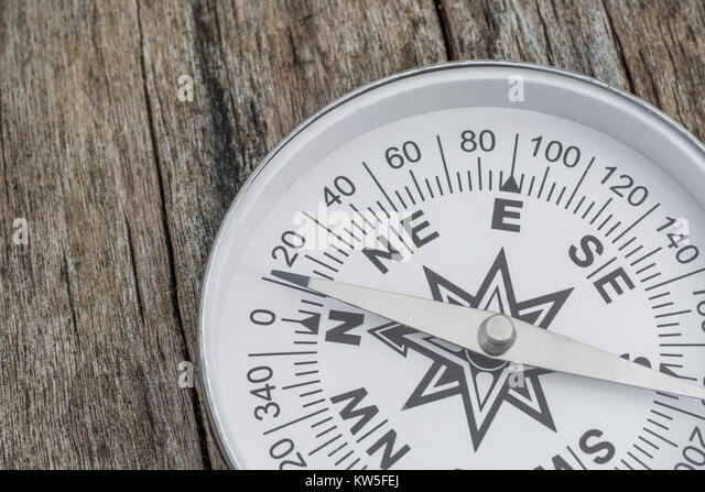 Compass - metaphor for business 'direction', navigation, moral compass, getting your bearings concept, orienteering. - Stock Image