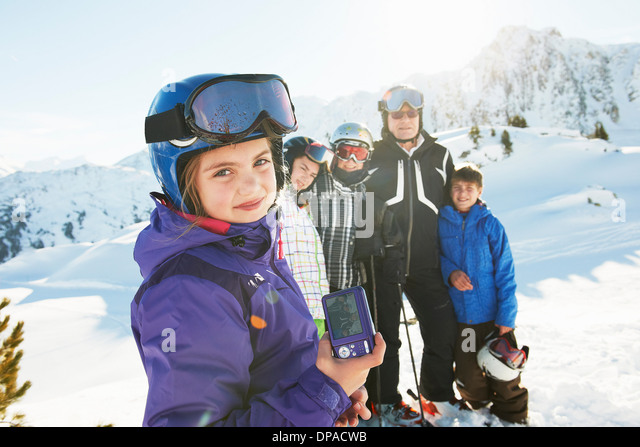 Family of skiers, Les Arcs, Haute-Savoie, France - Stock Image