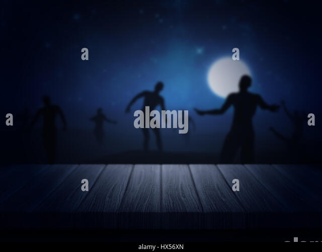 3D render of a wooden table looking out to a spooky Halloween zombie landscape - Stock Image