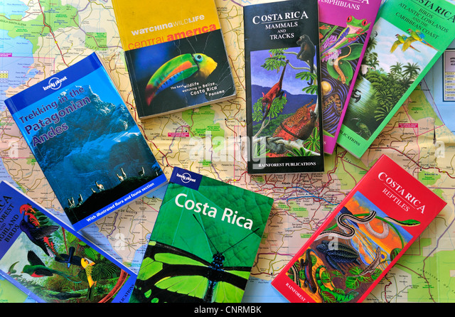 Road map and assortment of travel guides, guidebooks and wildlife books about Costa Rica in Central America and - Stock-Bilder
