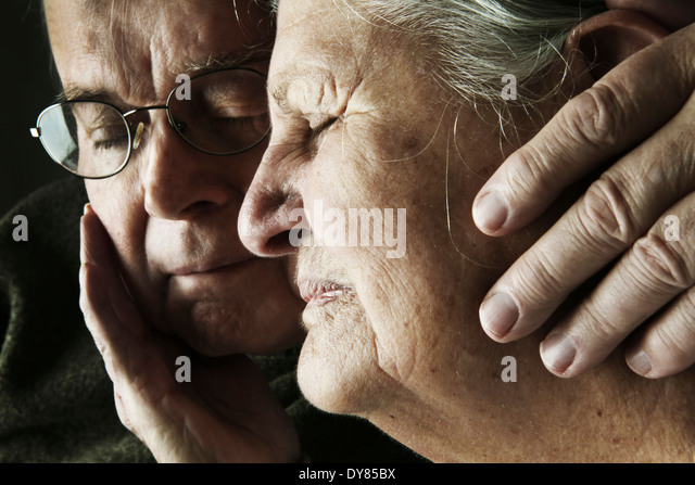 Portrait of senior couple with close eyes, close-up - Stock Image