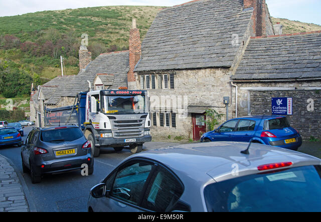 Corfe Castle , Dorset.  Heavy traffic can cause congestion and noise pollution in popular tourist villages. - Stock Image