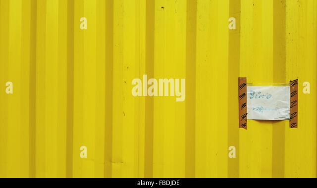 Information Sign On Yellow Wall - Stock Image