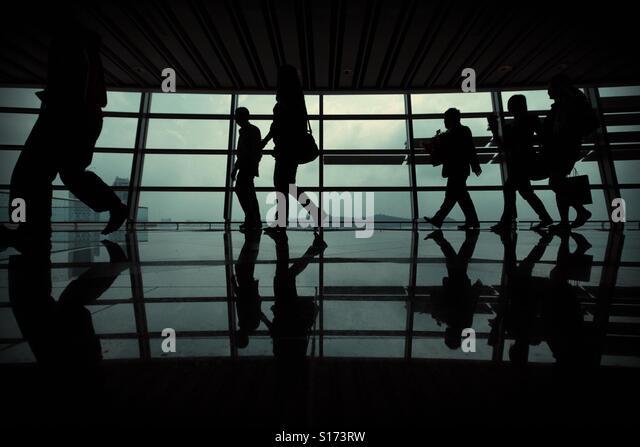 People walking over the windows - Stock-Bilder