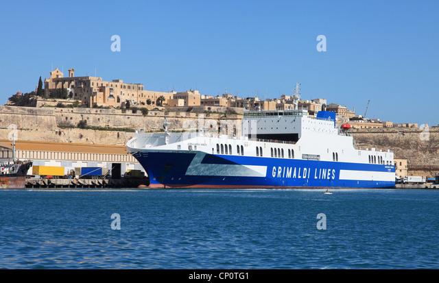 Grimaldi Lines Ro-Ro cargo vessel  Eurocargo Venezia in Valletta Harbour, Malta, Southern Europe. - Stock Image