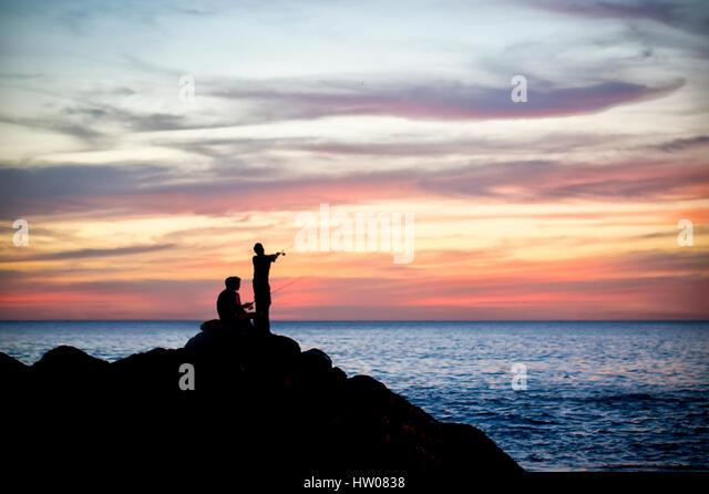 Silhouette of fisherman at sunset in Phuket - Thailand - Stock Image