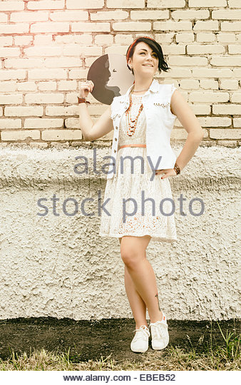 portrait of young active girl of the hipster outdoors - Stock Image