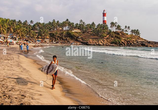 Kovallam beach, Surfer, lighthouse, India Kerala - Stock Image