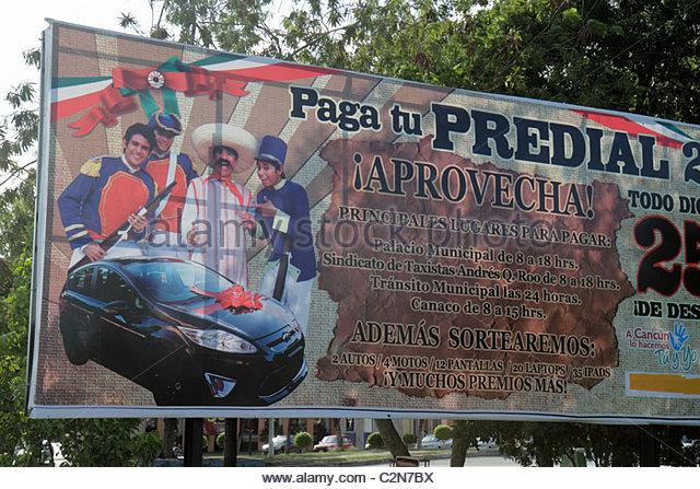 Cancun Mexico Yucatán Peninsula Quintana Roo Avenida Tulum billboard Spanish language advertising public service - Stock Image