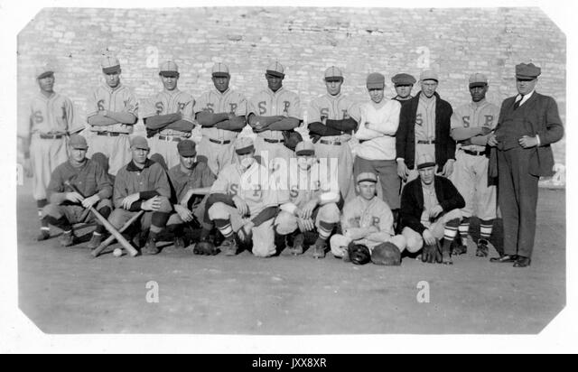 Portrait of the Nebraska state prison baseball team with neutral expressions, in uniforms, two of the members holding - Stock Image