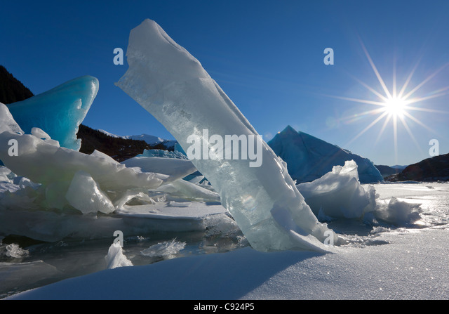 Scenic of large icebergs frozen in Mendenhall Lake on a sub zero sunny day, Inside Passage, Southeast Alaska, Winter - Stock Image