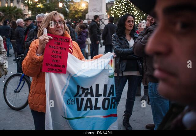 Palermo, Italy. 20th Dec, 2013. Palermo, Dec. 20, 2013 - A woman is holding a protest board and the flag of the - Stock Image