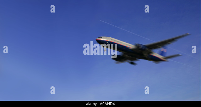 Commercial airplanes at low and high altitudes - Stock Image