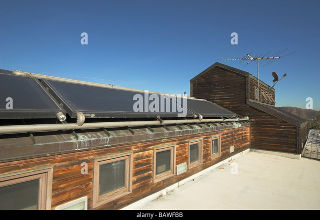 Roof mounted solar heaters - Stock Image