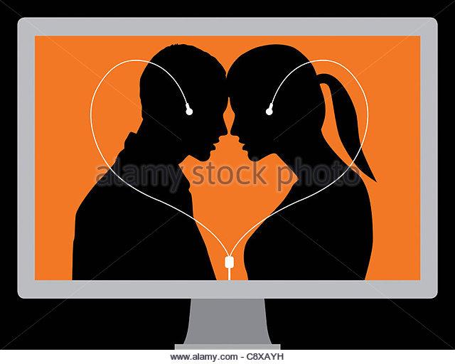 Couple connected by computer headphones - Stock-Bilder