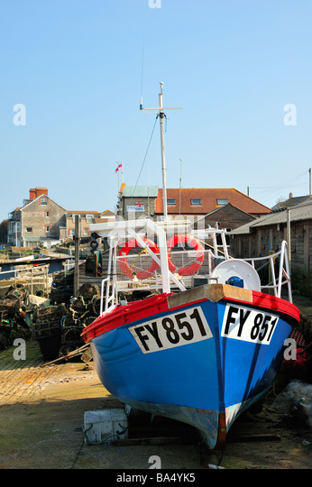 Small beached Fishing Boat at Swanage - Stock Image
