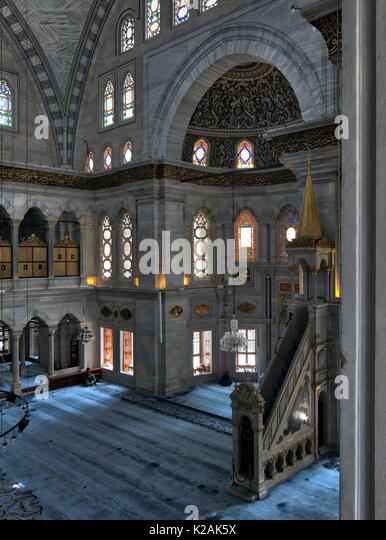 Interior shot of Nuruosmaniye Mosque, an Ottoman Baroque style mosque with minbar (platform), huge arches & - Stock Image