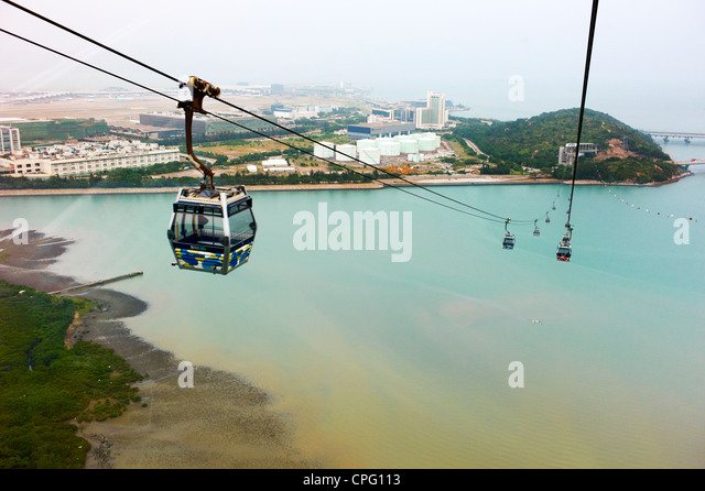 A cable car descends down the Po Lin Monastery on Ngong Ping, Lantau Island. - Stock Image