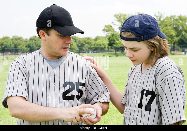Father and son with baseball - Stock Image