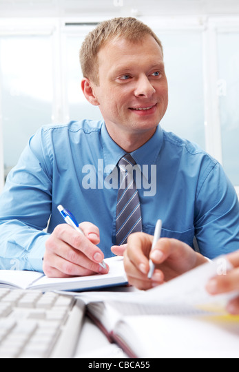 Portrait of young manager while talking - Stock Image