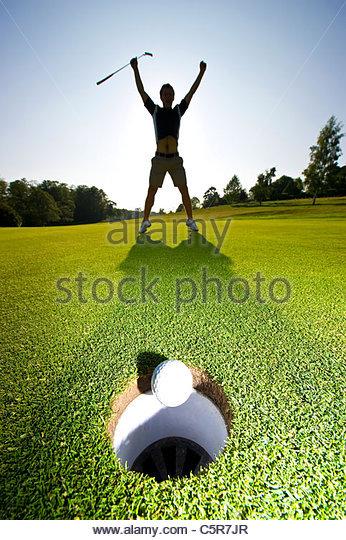 A Golfer celebrating a successful put. - Stock-Bilder