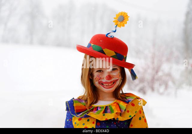 Clown girl in carnival costume - Stock Image