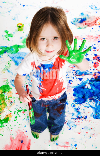 Preschool child holding her painted hand to the camera - Stock Image