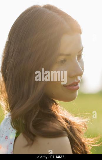Young brunette woman in sunlight, portrait - Stock-Bilder