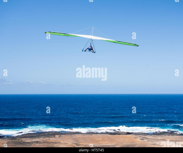Hang Glider taking off over the Atlantic Ocean in Las Palmas on Gran Canaria, Canary Islands, Spain - Stock Image