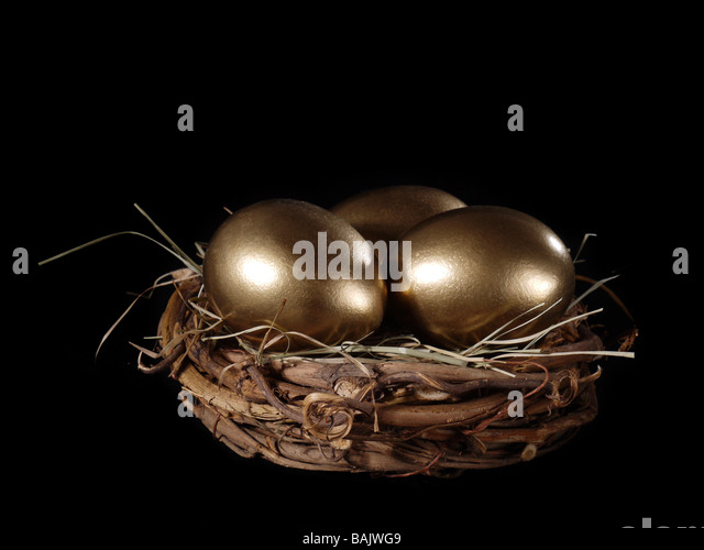 Three golden eggs in bird s nest over black background - Stock Image