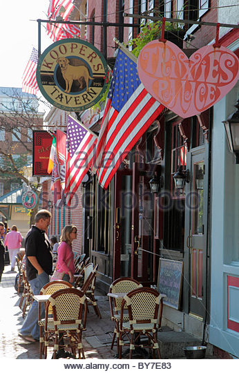 Baltimore Maryland Fells Point historic district neighborhood business sidewalk cafe man woman couple table sign - Stock Image