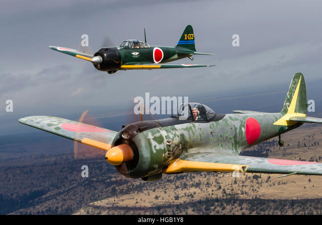 A Japanese A6M Zero and a Ki-43 Oscar fly above Madras, Oregon. - Stock Image