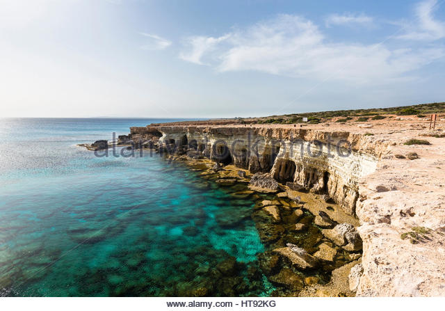 Coastline with Caves, Cape Greco, National Forest Park, Ayia Napa, Cyprus - Stock Image