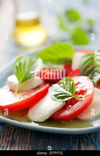 closeup of classic italian caprese salad, with mozzarella,basil and tomato - Stock Image