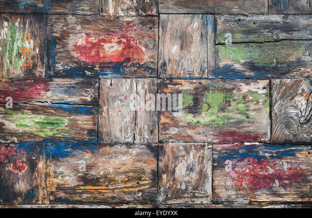Vintage style, painted in various colors, damaged old teakwood table board with rough surface and wood texture  - Stock-Bilder