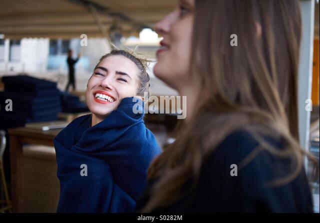 Two beautiful women enjoy the moment - Stock Image