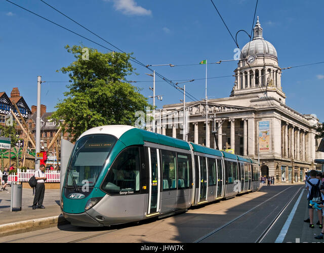 Nottingham electric tram system carriage in Old Market Square with Nottingham Council House building in the background, - Stock Image